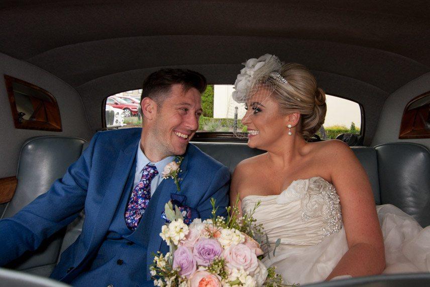Lisa and Gerard on the wedding car.